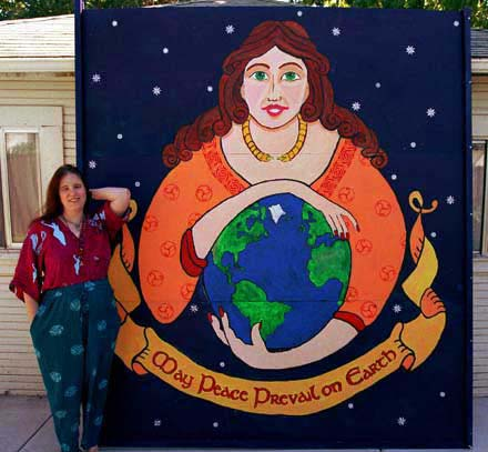 Rowan standing next to the finished mural